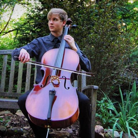 Alex Williams playing cello