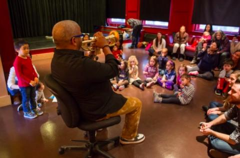 Man playing the trumpet during a KidsJam event