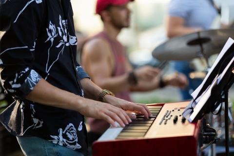 Keyboardist at outdoor concert