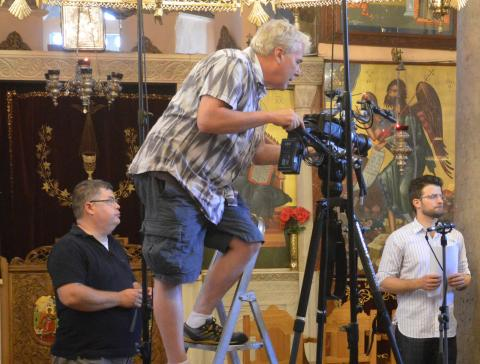 James Donahue working a video camera in a Byzantine cathedral