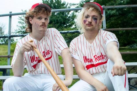 Members of the band Mom Rock pose in vintage baseball gear