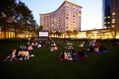 student's waiting for the movie to begin at the prudential center south garden