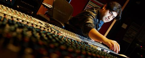 Student at a mixing board